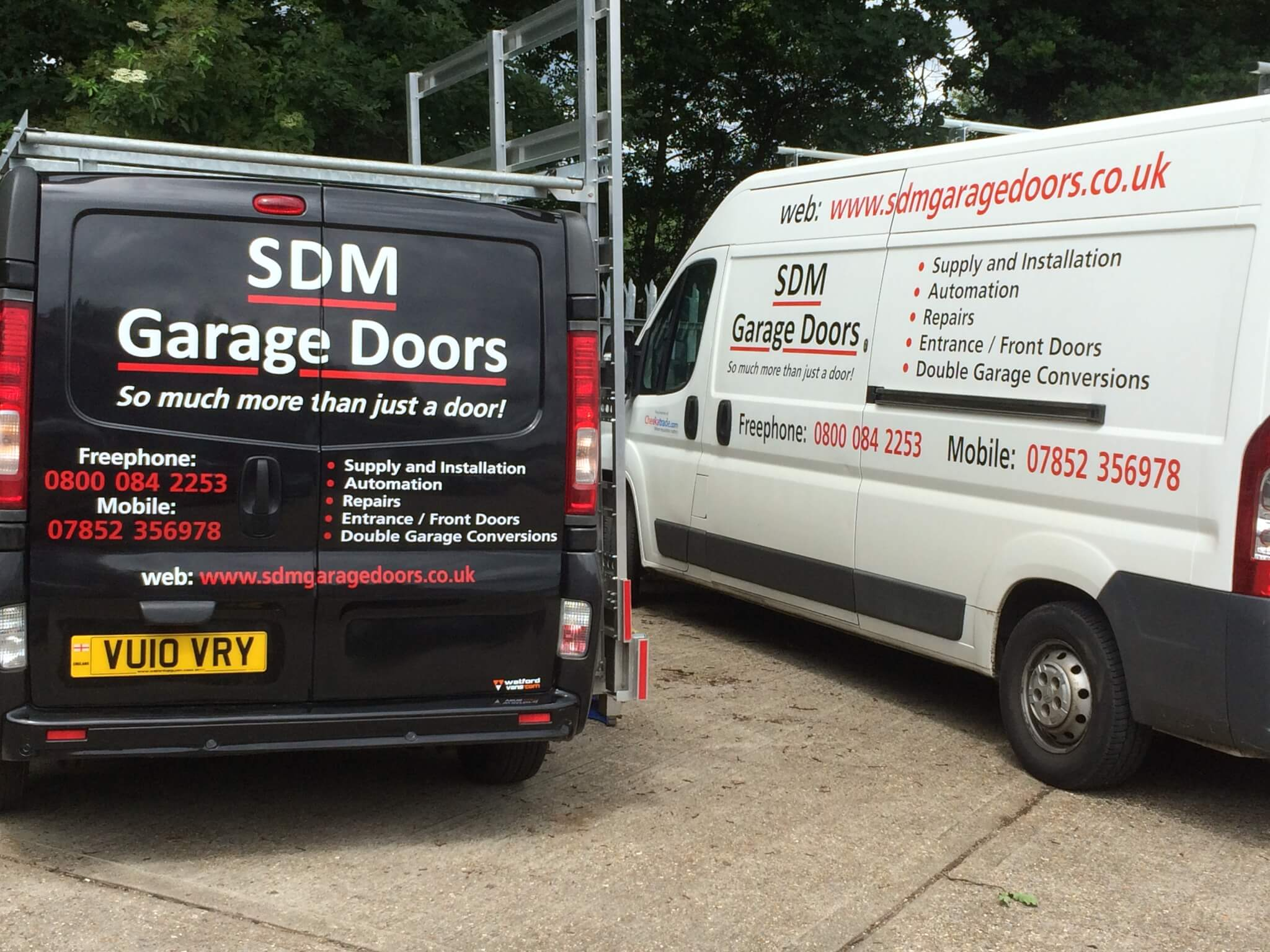 2448 #A4272C Us Sdm Garage Doors Are One Of The Leading Garage Door Front Door  image Garage Doors Company 35833264